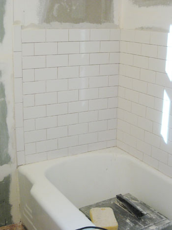 How to install subway tile in a shower marble floor tiles young house love - Installing tile around bathtub ...