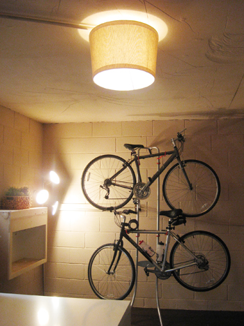 basement update hanging our bikes and adding a shade basement ceiling lighting