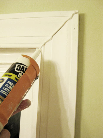 Bathroom renovation how to install baseboards trim for Door gap filler