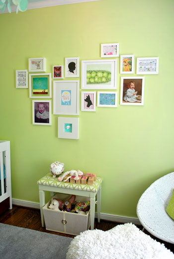 Fresh One of my favorite things on the wall are our baby pictures Clara loves looking at them and saying ucDaddy baby ud and ucMommy baby