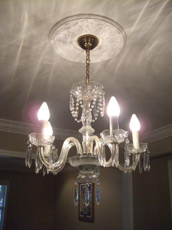 Reader redesign a contemporized chandelier young house love i was lucky enough to locate a fabulous shade for 10 at a warehouse sale here in dallas then i spray painted the ugly brass chain white along with the mozeypictures Choice Image