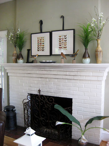 white painted brick fireplace