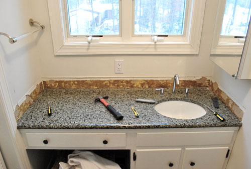 removing the side splash backsplash from our bathroom