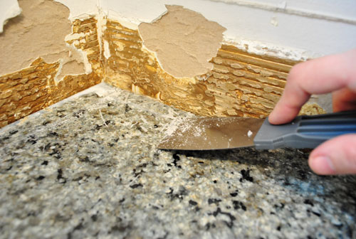 Kitchen Backsplash Removal caulking tile. kitchen update grouting caulking subway tile