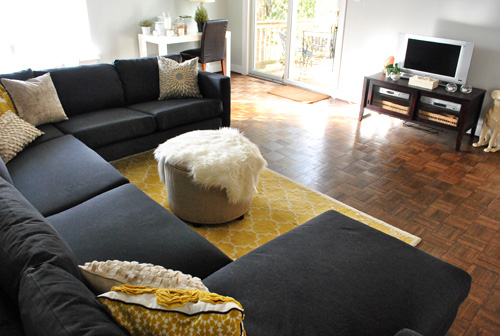 Dark Charcoal Gray Ikea Sectional Sofa In Living Room With Yellow Accents