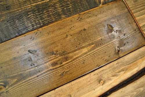 distressed wood look created by hitting bag of screws on whitewood and then staining dark