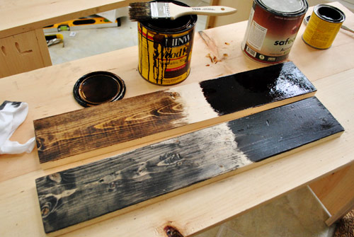 testing various stain finishes on scrap wood pieces to see which create the best old reclaimed look