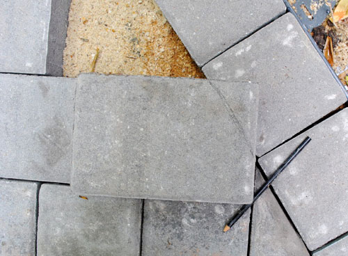 To cut, I entrusted my brother-from-an-inanimate-object-mother: the wet  saw. You may remember I fell in love with this guy during the bathroom  project in ... - How To Build A Paver Patio: It's DONE! Young House Love