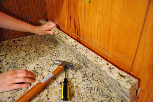 removing cabinets patching a vinyl floor tile young