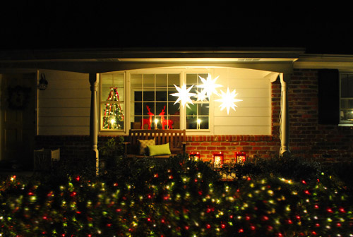 since its our first outdoor decorating foray its hardly one of those amazing every inch of the house is lit up things but we had some fun dipping our - Decorating Outside Of House For Christmas Pictures