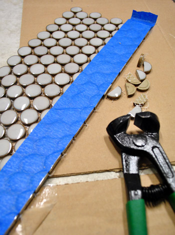 cutting penny tile can be tricky what worked for us