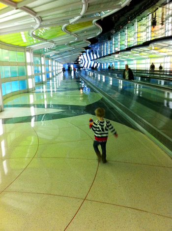 flying with toddler playing in the airport with cool lights