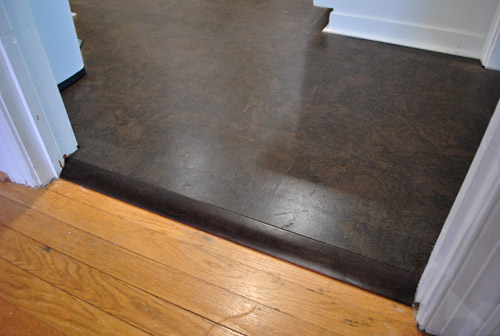 How to add floor trim transitions and reducers young for Flooring transition from kitchen to family room