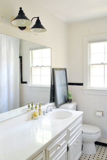 How To Paint Over Old Bathroom Cabinets replacing an old bathroom light | young house love