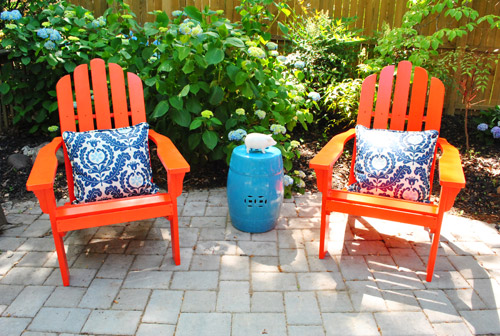 Red Patio Chair adding bright red adirondack chairs to our side patio | young