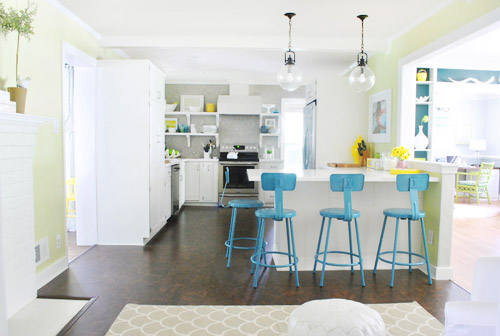 We love how the color relates to the dark teal built ins in the dining room without being too matchy matchy and even ties into the small pops of color on