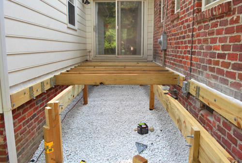 How to build a deck adding the joists young house love for Balcony joists