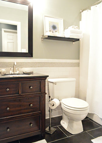 Stunning  the penny tile border along the wall the awesome dark floor tile and the vanity that they got from Lowe us It felt really classic and crisp in there