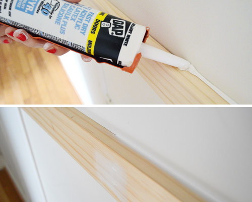 using DAP caulk in caulk gun to fill seams in do it yourself wood molding installation project