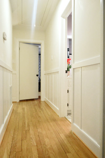 DIY board and batten painted white in hallway before walls are painted