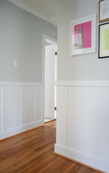 hallway with architectural interest including board and batten molding and outside corner edge