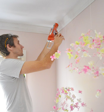 John adding caulk against ceiling where crown molding has slight gap