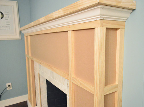 we also added another piece of decorative trim right where the vertical posts of the fireplace frame seemed to support the middle span that stretched