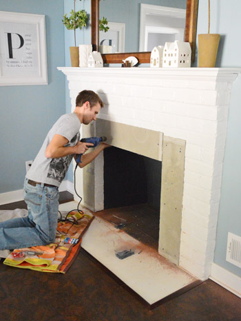 Fireplace Makeover: Tiling The Mantel With Marble Herringbone | Young House Love
