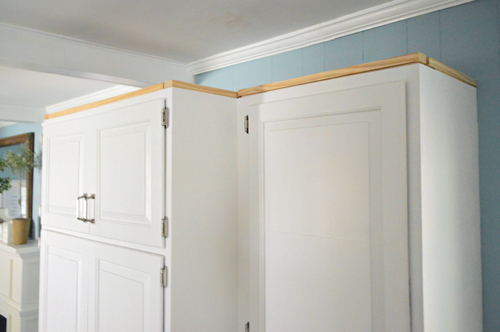 How to add crown molding to the top of your cabinets for Attaching crown molding to kitchen cabinets