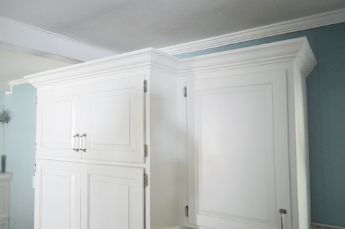 you may remember that the few upper cabinets in our kitchen have lived a very humble life so far  how to add crown molding to the top of your cabinets   young house      rh   younghouselove com