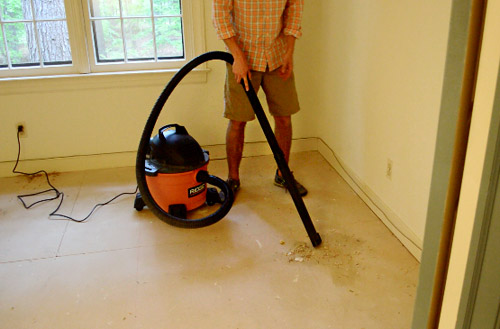 using shopvac to suck up carpet removal debris