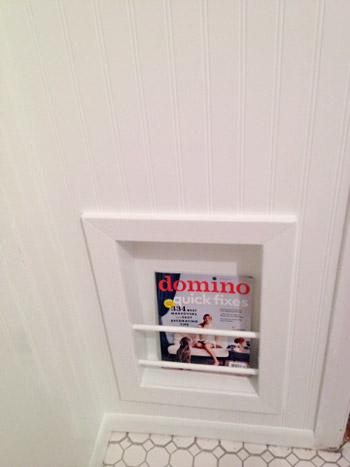 Reader redesign bathroom red white blues young house love for Recessed in the wall bathroom magazine rack