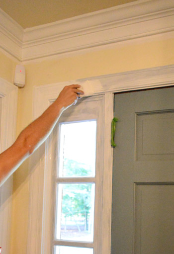 priming and painting trim with a paint sprayer andhand | young