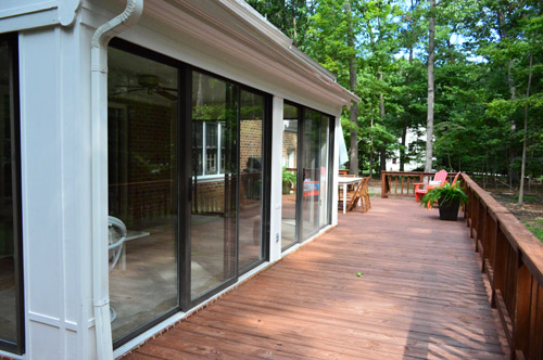 Open 39 er up converting a sunroom into a veranda young for Sliding glass doors sunroom