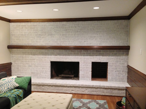 darker whitewash technique on brick wall fireplace using two coats of watered down white paint