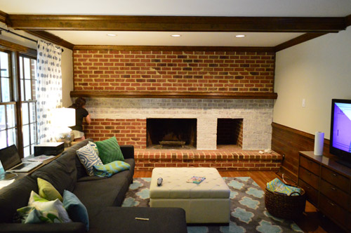 whitewash brick technique being applied to living room fireplace wall made of brick