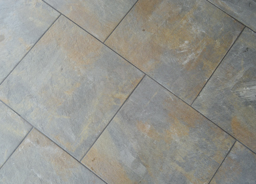 Light floor tile with dark grout
