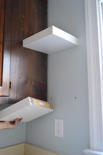 showing how short Ikea LACK floating shelves are attached to kitchen wall