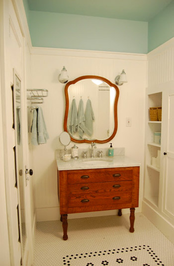 The first step was taping a horizontal border around the room where we  wanted our blue color to start. We landed on about 8 down from the ceiling,  ...