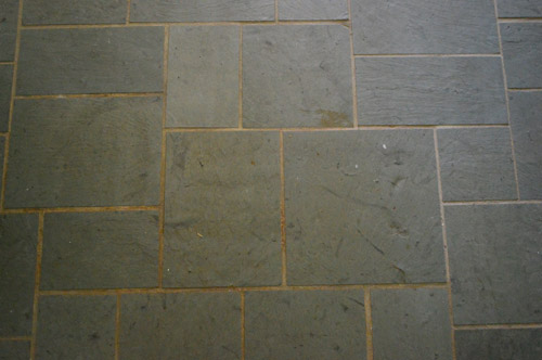 Old Discolored Dirty Grout Lines On Slate Tile Entryway Floor