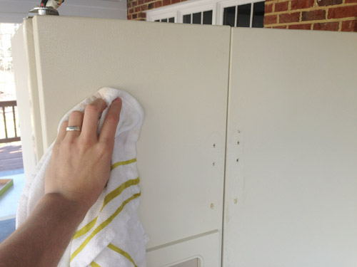 cleaning refrigerator door of sanding dust before painting