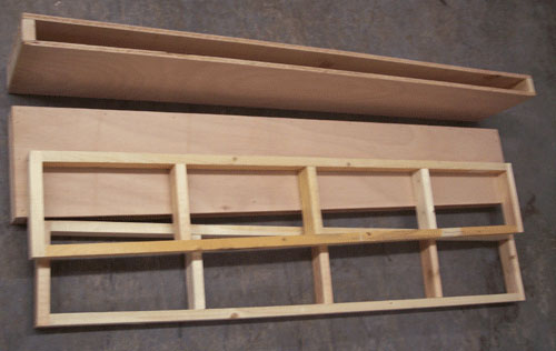 Photo of two frame pieces and two shelf boxes for DIY floating shelf project