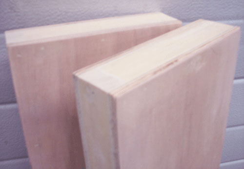 detail close-up of wood filler applied to DIY floating shelf building project