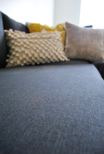 close up detail of ikea sectional sofa fabric in dark sivik gray