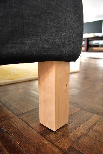 close up detail of ikea sectional sofa legs in unfinished blonde wood