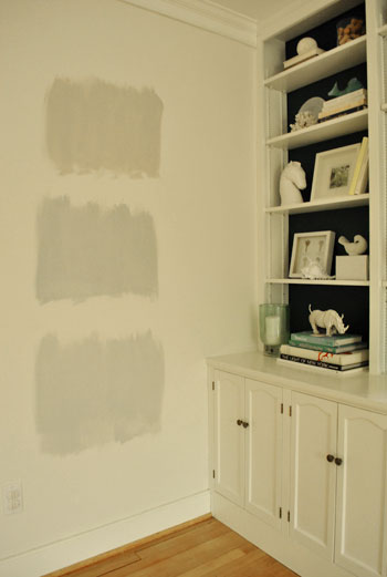 testing gray paint swatch colors on the wall during nighttime light