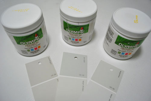 testing three Benjamin Moore gray paint options mixed in Olympic paint test cans - Collingswood Grey Owl and Moonshine