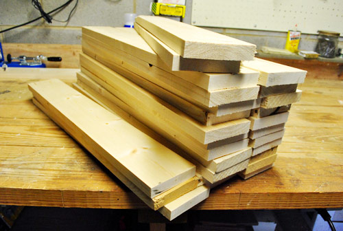 store bought 1x4 whitewood planks that have ben cut for use in console furniture building project