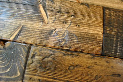 hammer marks on distressed wood DIY project after applying dark stain finish
