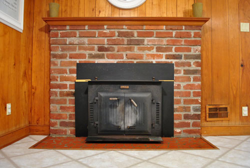 The Beginning Of A Fireplace Makeover Removing Woodstove